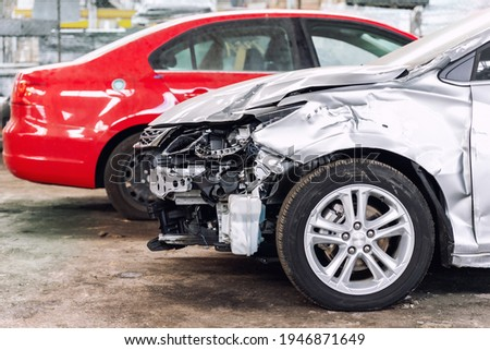 Many wrecked car after traffic accident crash at restore service maintenance station garage indoor. Insurance salvage vehicle auction wholesale storage. Auto body wreck damage work workshop center Royalty-Free Stock Photo #1946871649