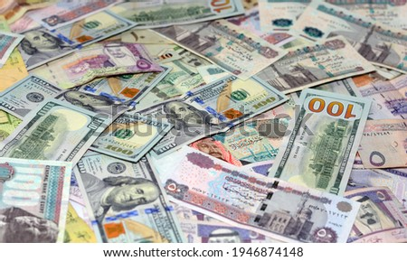 selective focus of Saudi Arabia currency with USA currency and Egypt currency banknotes. blurred money . Saudi Arabia riyals, Egyptian pounds and American dollars exchange rate. Royalty-Free Stock Photo #1946874148