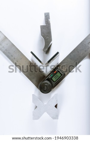Sheet metal bending tool and equipment isolated on a white background. Electronic digital protractor.