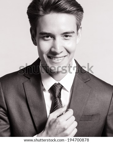 Handsome business man smiling. #194700878