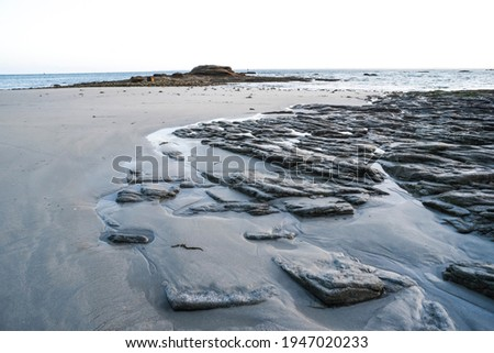 High tide, the phenomenon of tides in the Atlantic Ocean, an exposed beach off the coast of France. Royalty-Free Stock Photo #1947020233