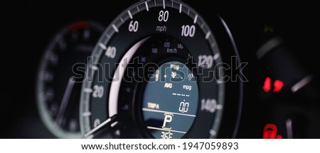 Miles Speedometer of Modern car close up. Modern car speedometer. Panoramic shot of the dashboard a car. Royalty-Free Stock Photo #1947059893