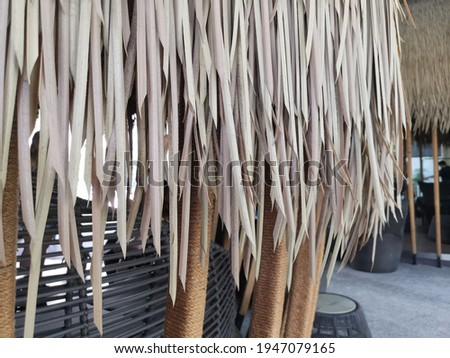 Thatch roof background, hay or dry grass background, Thatch roof texture. Royalty-Free Stock Photo #1947079165