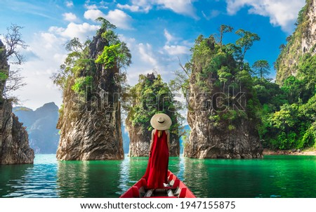 Woman traveler on boat joy nature view rock island scenic landscape Khao Sok National Park, Famous attraction adventure place travel Thailand, Tourism beautiful destinations Asia holiday vacation trip Royalty-Free Stock Photo #1947155875