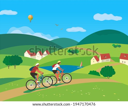 Couple Travelling by Bicycles on Green Farmland vector. Landscape village rural houses community cartoon. Hand drawn carefree tourist trip summer countryside background. Vacation travel illustration Royalty-Free Stock Photo #1947170476