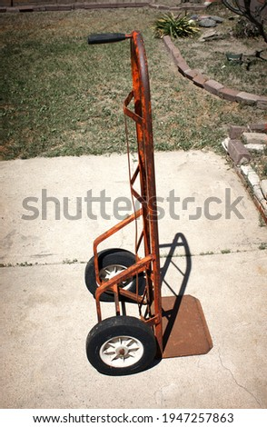 Old vintage rusted handcart trolley Royalty-Free Stock Photo #1947257863