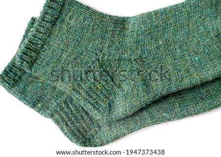 Woolen socks. Suitable for a wide variety of situations, you can post their photo in the office, school, camping, outdoors, in sports, indoors, at home, at work, in winter, or in any cold and snowy