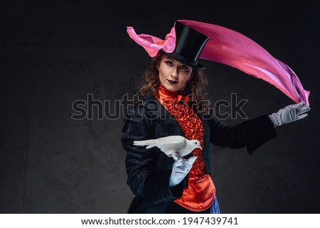 Professional performer and single pigeons in dark background Royalty-Free Stock Photo #1947439741