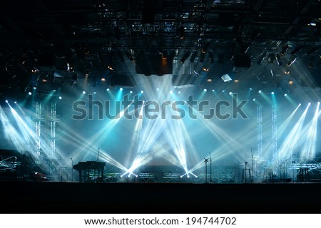 Lights beams on stage with piano and musical instruments Royalty-Free Stock Photo #194744702