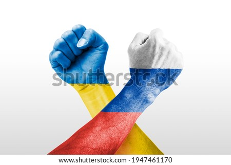 Ukraine vs Russia war, country flags and fist  Royalty-Free Stock Photo #1947461170