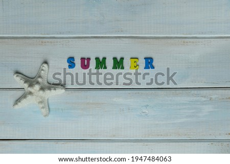 word summer is made up of volumetric color letters on a light blue wooden background, white starfish, summer time concept, vacation time, travel, boat trip, beach impressions