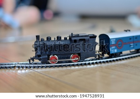 Miniature toy train with metal rails, scale 1:120. Vintage toy from 80's.