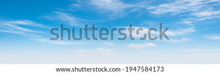 Air clouds in the blue sky.blue backdrop in the air. abstract style for text, design, fashion, agencies, websites, bloggers, publications, online marketers, brand, pattern, model, animation, Royalty-Free Stock Photo #1947584173