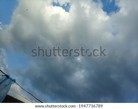 A picture of beautiful clouds at the blue sky the rainy clouds looking very nice Black clouds you may also like it