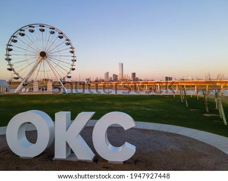 OKC sign and Wheeler Ferris Wheel with skyline  Royalty-Free Stock Photo #1947927448