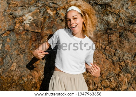 Happy woman in white crop top outdoor photoshoot Royalty-Free Stock Photo #1947963658