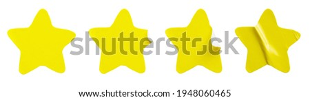 Yellow star shape paper sticker label set isolated on white background Royalty-Free Stock Photo #1948060465
