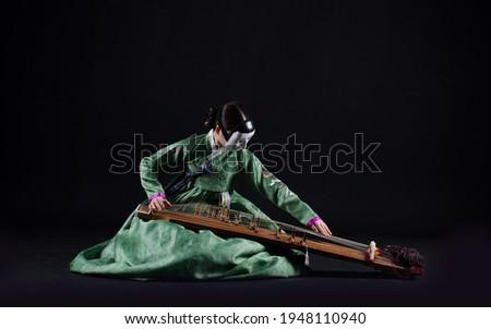 Korean traditional culture,Performance, Hanbok, Instrument, Gayageum, Janggu Royalty-Free Stock Photo #1948110940