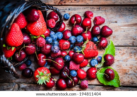Berries mix on rustic background #194811404