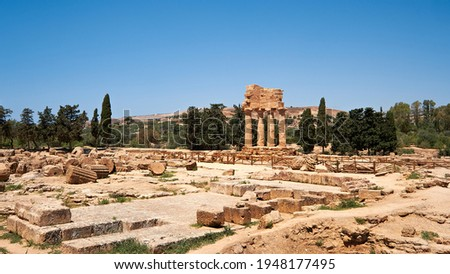 The temple of Castor and Pollux, Dioscuri brothers, panoramic banner image. It has only four columns left and has become the symbol of Agrigento. Valley of the Temples in Agrigento, Sicily, Italy.
