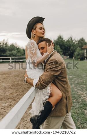 Beautiful wedding couple.  Bohemian wedding  at the ranch. Magic sunset Royalty-Free Stock Photo #1948210762