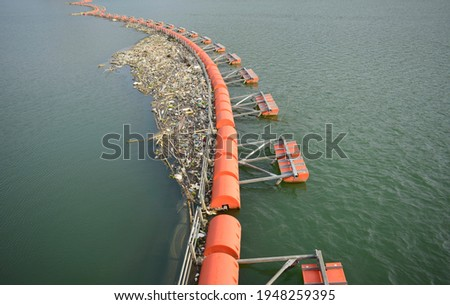 Buoy obstruct and cleaned garbage on river. Royalty-Free Stock Photo #1948259395