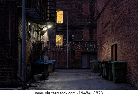 empty back alley at night  Royalty-Free Stock Photo #1948416823