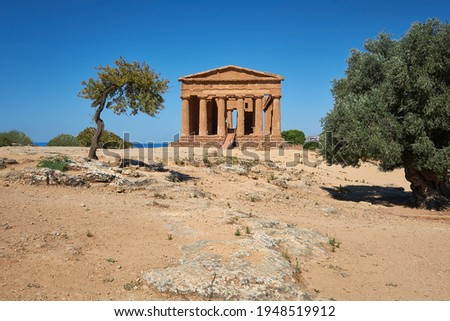 Temple of Concordia, or Tempio della Concordia in Italian. Temple building with olive trees. Valley of Temples, Agrigento, Sicily, Italy.