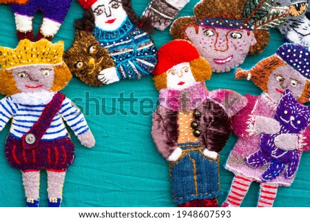 Flea market,  folk crafts. Handmade rag dolls. A rag doll is a children's toy. It is a cloth figure, a doll traditionally home-made from (and stuffed with) spare scraps of material. Royalty-Free Stock Photo #1948607593