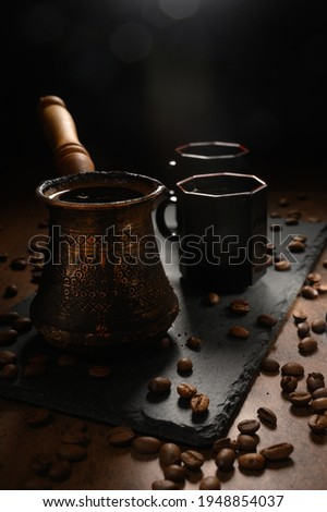 Turkish Jezve Coffee Pot with hot coffee at coffee beans background hd
