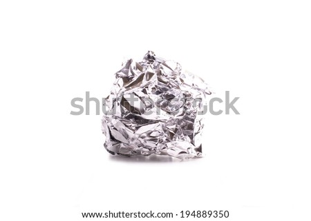 crumpled aluminum foil ball isolated on white background  #194889350