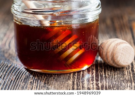 dipped in honey specially made from wood homemade coarse spoon, sweet bee honey and wooden spoon that allows you to transfer and pour honey without dripping and spreading
