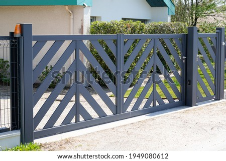 modern gate grey steel design home portal of private house Royalty-Free Stock Photo #1949080612