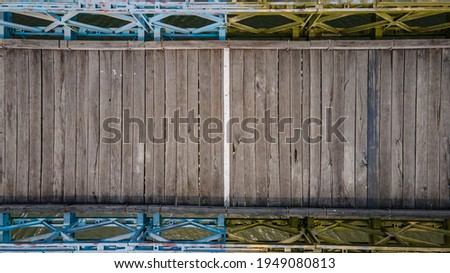 f wooden planks paved on Hien Luong bridge in Vinh Linh District, Quang Tri Province, Vietnam. Royalty-Free Stock Photo #1949080813