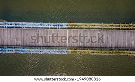 wooden planks paved on Hien Luong bridge in Vinh Linh District, Quang Tri Province, Vietnam. Royalty-Free Stock Photo #1949080816