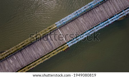 wooden planks paved on Hien Luong bridge in Vinh Linh District, Quang Tri Province, Vietnam. Royalty-Free Stock Photo #1949080819