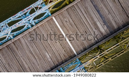 wooden planks paved on Hien Luong bridge in Vinh Linh District, Quang Tri Province, Vietnam. Royalty-Free Stock Photo #1949080822