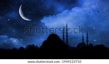 Ramadan Kareem background. Mosque silhouette in night sky with crescent moon and star Royalty-Free Stock Photo #1949123710