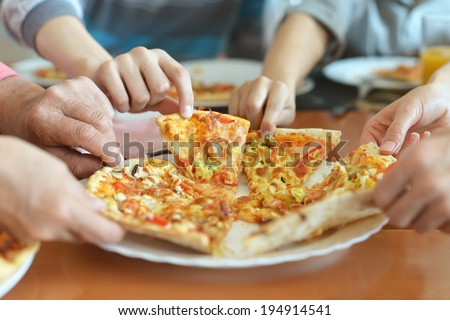Big family hands taking pizza from plate #194914541