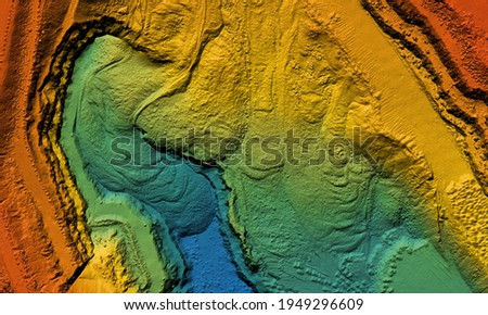 Model of a mine elevation. GIS product made after processing aerial pictures taken from a drone. It shows excavation site with steep rock walls Royalty-Free Stock Photo #1949296609