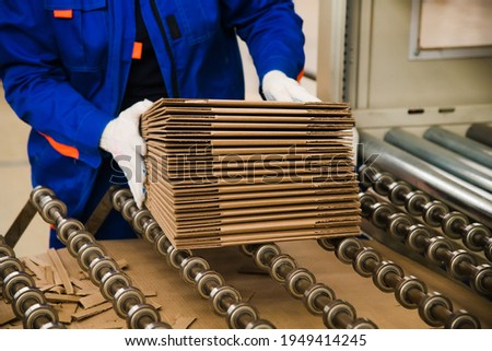 Production line for the production of cardboard and corrugated cardboard in the factory Royalty-Free Stock Photo #1949414245