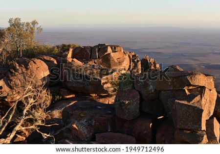 Late afternoon sun reflecting off rocks in the Valley of Desolation near the Karoo town of Graaff-Reinet in the Eastern Cape Royalty-Free Stock Photo #1949712496