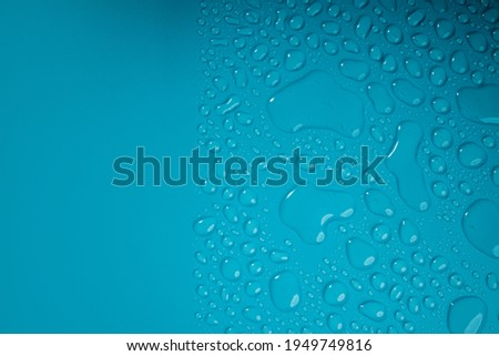 Water Drops on Blue Background. World Water Day Concept. Droplet Texture Surface. Environment Care. CSR, Corporate Social Responsibility or CSC, Corporate Social Contribution Royalty-Free Stock Photo #1949749816