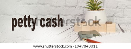 The concept of a small cash balance of financial accounts written on a copy of the space with an office light background, banner.