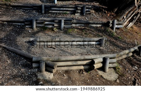 stair construction made of wooden poles used as palisades. a wooden staircase leading down the slope to the water is an anti-erosion element in the landscape Royalty-Free Stock Photo #1949886925