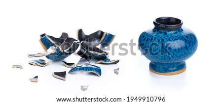 Ceramic vase and its broken form on isolated white background Royalty-Free Stock Photo #1949910796