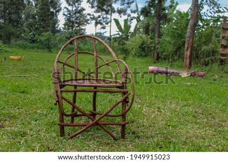 A wooden chair in a field