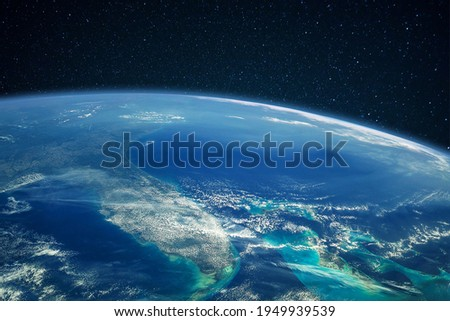 Blue planet earth with ocean and continents in open space on the starry sky Royalty-Free Stock Photo #1949939539