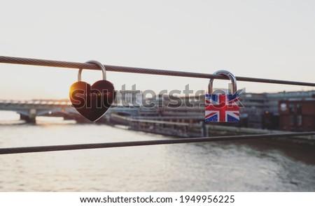 Red heart shaped love lock Always and forever sign symbol british flag padlock on Millennium bridge railing Thames river London England Great Britain GB, United Kingdom UK Europe