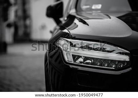 Headlight of black car. Led car headlight Royalty-Free Stock Photo #1950049477